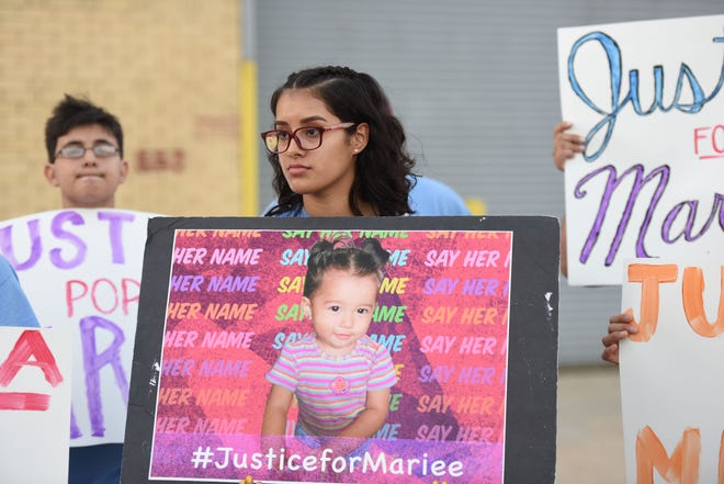 Xenia Rivas holds a photo at a vigil calling for #JusticeforMariee  in front of the Elizabeth Detention Center. Mariee, a 19-month old baby died after being released from Dilley, TX ICE detention center run by CoreCivic. She fell ill while detained and her mother's lawyer claims the little girl received inadequate medical care from ICE
