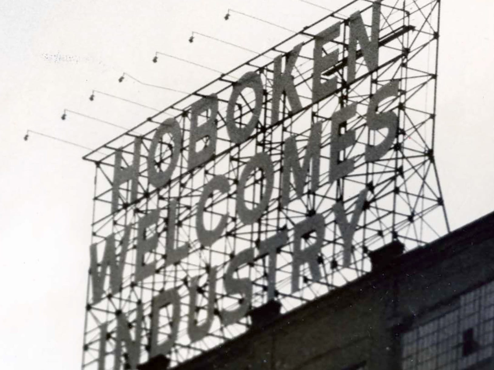 A sign promotes Hoboken's thriving factory industry in 1966.