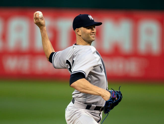 Sep 4, 2018; Oakland, CA, USA; New York Yankees starting pitcher J.A. Happ (34) delivers against the Oakland Athletics during the first inning of a Major League Baseball game at Oakland Coliseum.