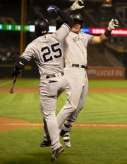 Sep 4, 2018; Oakland, CA, USA; New York Yankees Mike Voit, right, celebrates his solo home run with teammate Gleyber Torres (25) during the eighth inning of a Major League Baseball game against the Oakland Athletics at Oakland Coliseum.