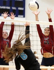 Sophomores Kamryn Zachek, left, and Katie Morgan team for a block during Tuesday's three-game loss to the visiting Santa Teresa Desert Warriors.