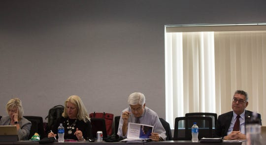 New Mexico State University Regents Debra Hicks, left, and Kari Mitchell, right,  Dan Arvizu, chancellor of NMSU and John Floros, president of NMSU, listen during a presentation of  an institutional analysis diagnosing lack of communication and strategic focus  Wednesday, Sept. 5, 2018, at Corbett Center.