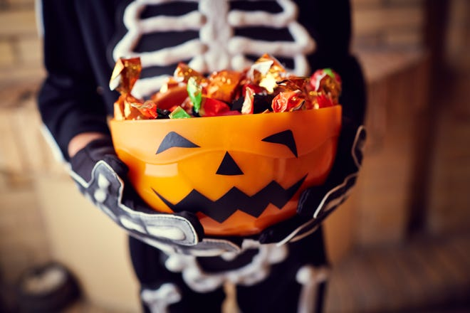 Parents can make Halloween healthier for kids by regulating how much candy they consume per day, or letting them pick their favorites and then giving the rest away.