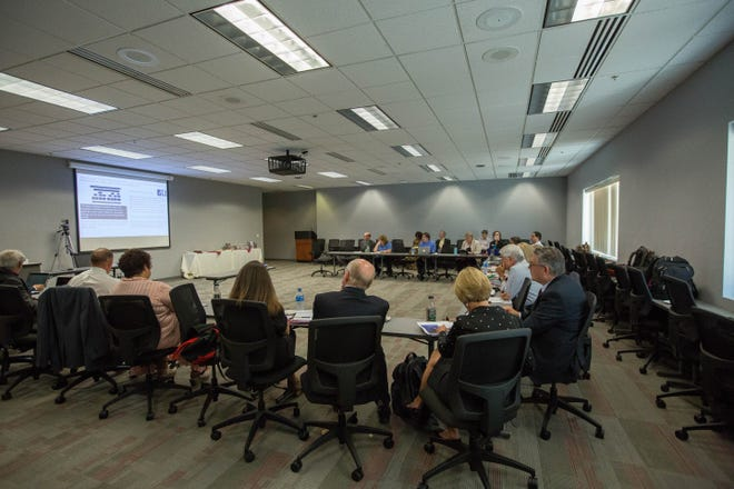 New Mexico State University regents, along with Chancellor Dan Arvizu, President John Floros and other administrators, participate in a work session on Wednesday, Sept. 5, 2018, at Corbett Center.