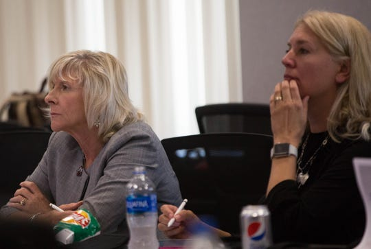 New Mexico State University Regents Chair Debra Hicks, left, and Vice Chair Kari Mitchell, right, listen to the results of an institutional analysis during a work session Wednesday, Sept. 5, 2018, at Corbett Center.