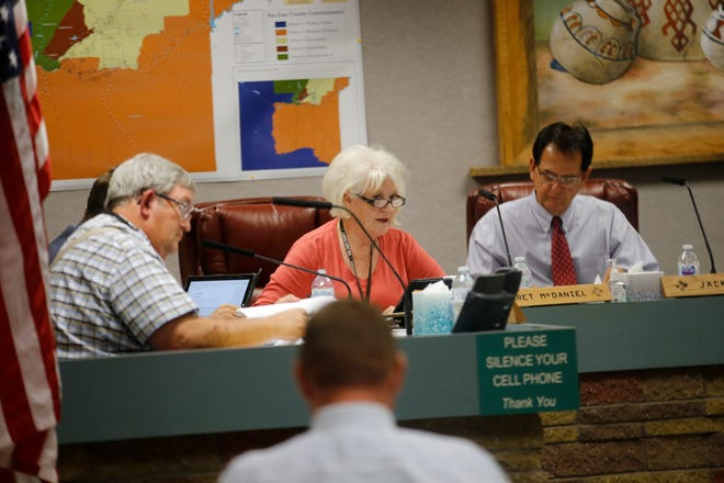 San Juan County Commissioner Margaret McDaniel talks Wednesday during the commission meeting at the county administration building in Aztec.