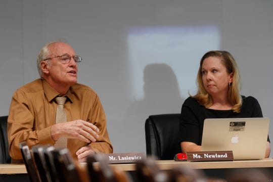 Chief of operations Ted Lasiewicz, left, talks about the district's possible purchase of the Hillcorp building Wednesday during a Farmington school board meeting at the district's central office.