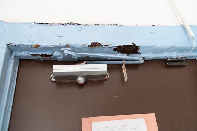 Deteriorated paint  above a classroom door greets students in Hernandez Elementary School in Hernandez.