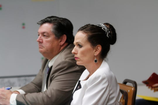 San Juan College Executive Vice President Ed DePlas and San Juan College President Toni Pendergrass listen during a Farmington school board meeting Wednesday at the district's central office.