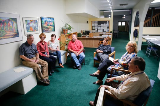 armington community members join Chris Hunter, left, WESST Farmington Regional Manager to discuss the business resiliency project during an interview Wednesday at the Complete Streets Headquarters on West Main Street in Farmington.