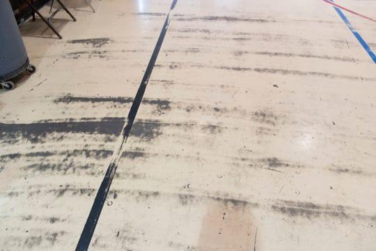 Wear and tear are visible on this floor inside Hernandez Elementary School in Hernandez.