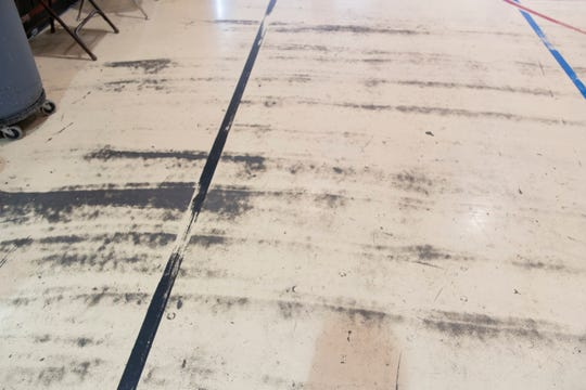 Wear and tear are visible on this floor inside Hernandez Elementary School in Hernandez.