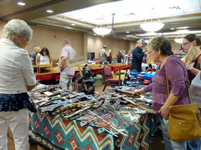 Crosses seemed to fascinate these shoppers at the All American Gun & Western Collectibles Show in Ruidoso.