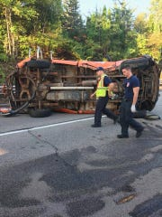 Two workers were injured when a Road Commission for Oakland County truck was struck by another vehicle and flipped over Sept. 5.