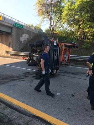 Two Road Commission for Oakland County employees were inside a pickup truck that was struck and rolled over Sept. 5 on M-5.