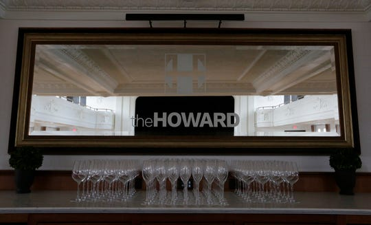 A mirror behind the bar reflects the grand ballroom at The Howard in Oshkosh. Co-owners Jenna Golem and Carey Sharpe will soon be done renovating the historic building.