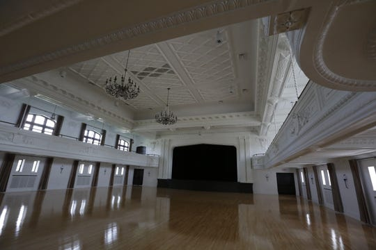 Chandeliers hang from the ceiling of the grand ballroom Tuesday, Sept. 4, 2018, at The Howard in Oshkosh. Co-owners Jenna Golem and Carey Sharpe will soon be done renovating the historic building, formerly known as the Eagle's Club.