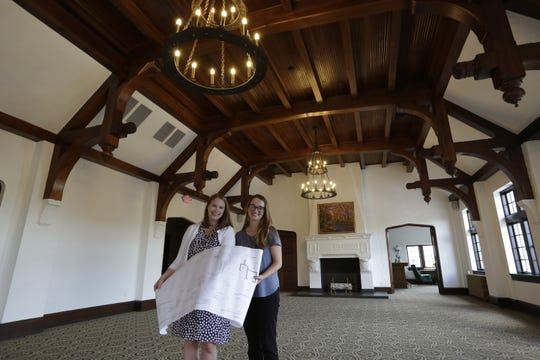 Sisters Jenna Golem and Carey Sharpe hold design plans in an event space inside The Howard in Oshkosh. The newly renovated historic building was formerly known as the Eagle's Club.