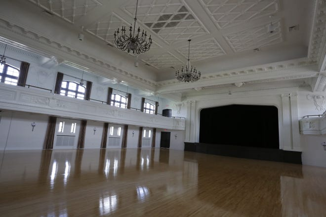 Chandeliers hang from the ceiling of the grand ballroom Tuesday at The Howard in Oshkosh. Co-owners Jenna Golem and Carey Sharpe will soon be done renovating the historic building, formerly known as the Eagle's Club.