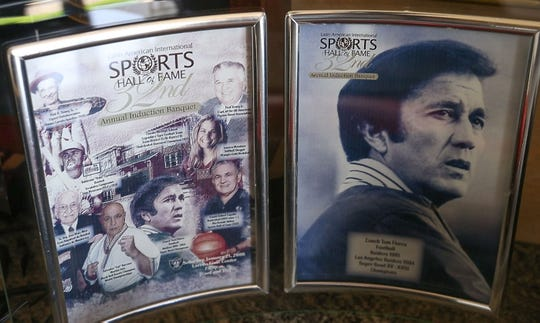 A framed picture of Tom Flores from the Latin American International Sports Halls of Fame 32nd annual induction banquet.
