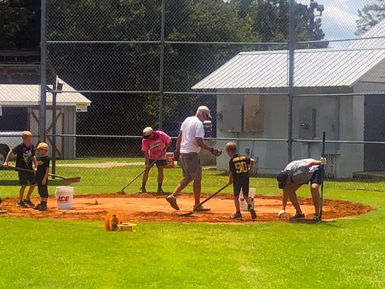 Volunteers organized by the Blue Wahoos renovate a cluster of fields at Showalter Park in Century.