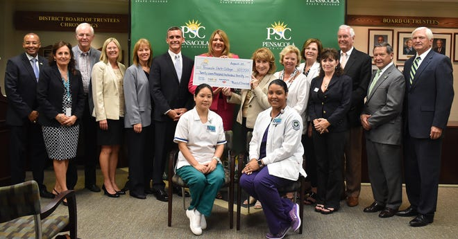 Florida College System Chancellor Madeline Pumariega and Florida College System Foundation President Judy Green presented $27,220 in scholarship funds to Pensacola State College President Ed Meadows on Aug. 29, 2018. The funds were matched by donations from local supporters. The Florida College System funds were donated by Florida Blue, the Helios Education Foundation and Bank of America's Dream Makers Program.