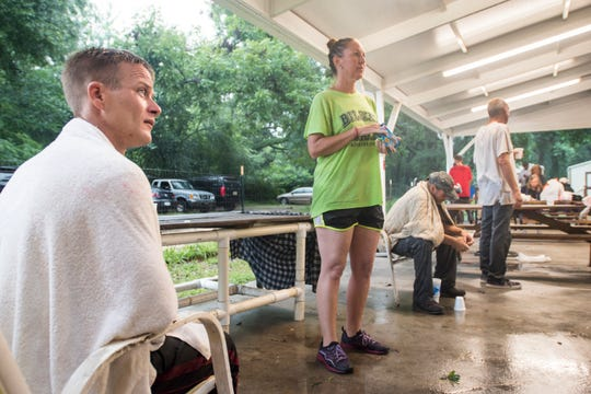 John Roberts, left, talks about his experience with Tropical Storm Gordon as he and other clients ride out the continuing rain at the Alfred-Washburn Center in Pensacola on Wednesday.