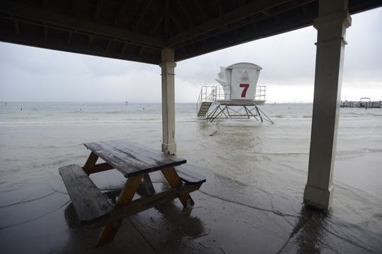 Water creeps up to the Quietwater Beach gazebos  after Tropical Storm Gordon.