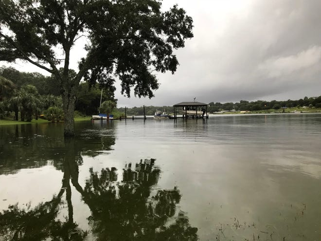 Flood waters rise in Bayou Texar after Tropical Storm Gordon dumped heavy rains on the Pensacola area overnight Tuesday and into Wednesday.