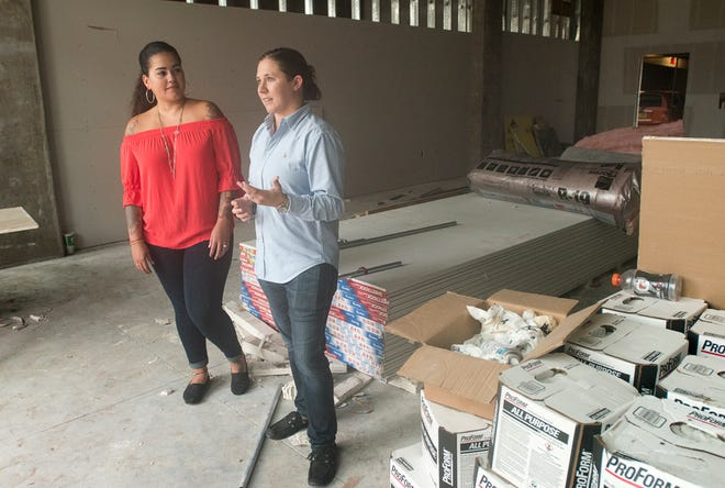 Owners Cristi Fonseca Ramirez, left, and Lauren Schneider talk about their plans for the Old City Market that will soon open on South Jefferson Street in downtown Pensacola.