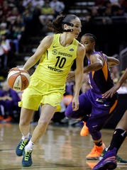 Seattle Storm's Sue Bird (10) drives past Phoenix Mercury's Yvonne Turner during the first half of Game 5 of a WNBA basketball playoffs semifinal, Tuesday, Sept. 4, 2018, in Seattle.