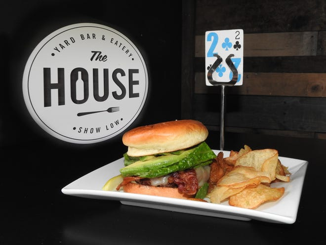 A big juicy burger at the House in Show Low is served with homemade chips.
