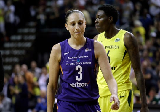 Phoenix Mercury's Diana Taurasi (3) walks upcourt after a call in favor of the Seattle Storm late in the second half of Game 5 of a WNBA basketball playoff semifinal, Tuesday, Sept. 4, 2018, in Seattle. The Storm won 94-84 and advanced to the finals.