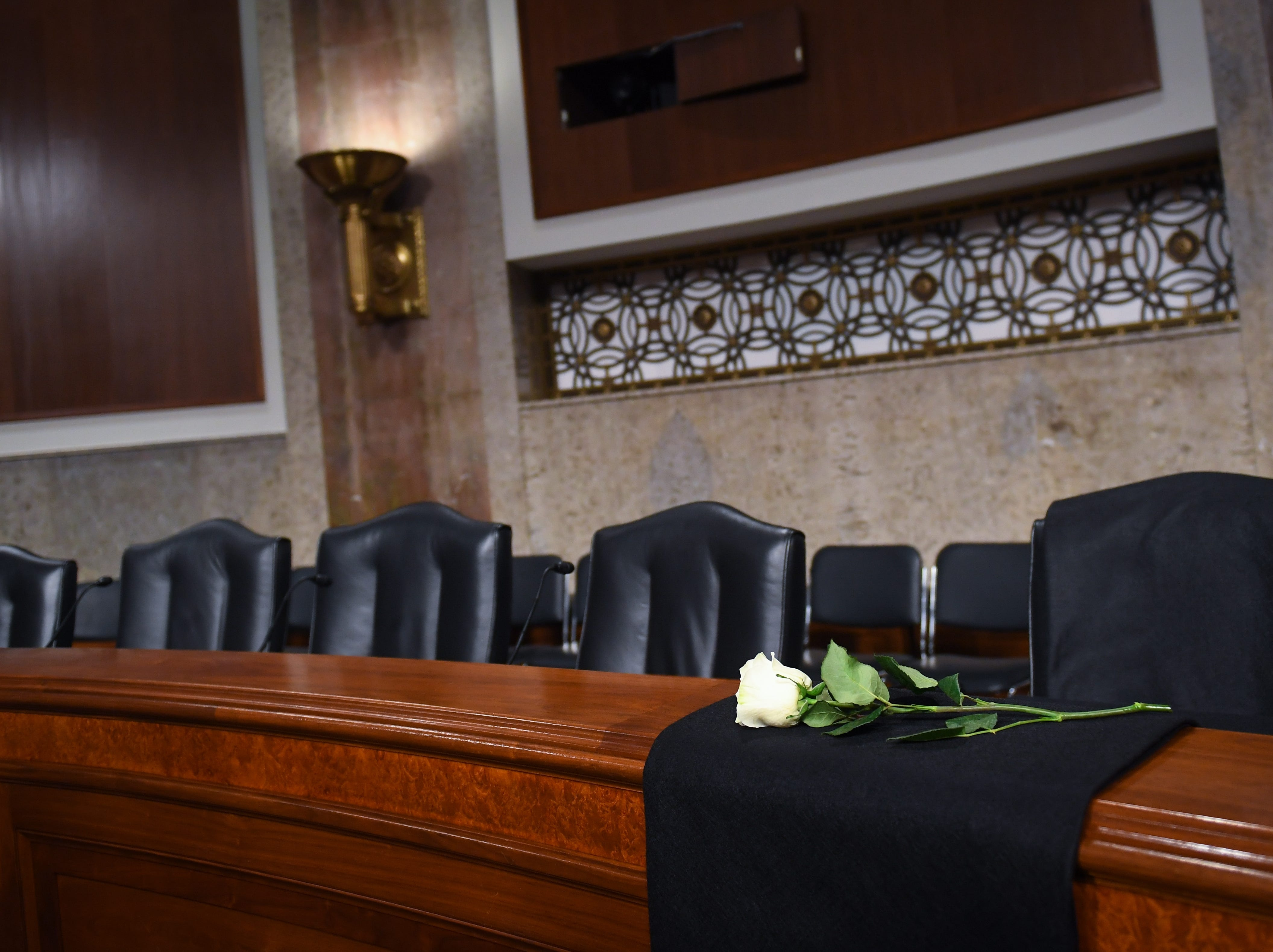 A white rose in place in remembrance of committee member Sen. John McCain before Sheryl Sandberg, chief operating officer of Facebook Inc., and Jack Dorsey, chief executive officer of Twitter Inc., would testify before the Senate Select Committee on Intelligence during a hearing on Foreign Influence Operations Use of Social Media Platforms on Sept. 5, 2018, in Washington
