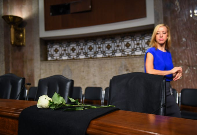 A white rose in place in remembrance of committee member Senator John McCain before Sheryl Sandberg, chief operating officer of Facebook Inc., and Jack Dorsey, chief executive officer of Twitter Inc., would testify before the Senate Select Committee on Intelligence during a hearing on Foreign Influence Operations Use of Social Media Platforms on Sept. 5, 2018, in Washington.