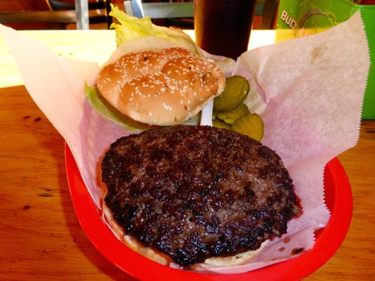 The Lion's Den in Pinetop is known for juicy half-pound wine burgers.