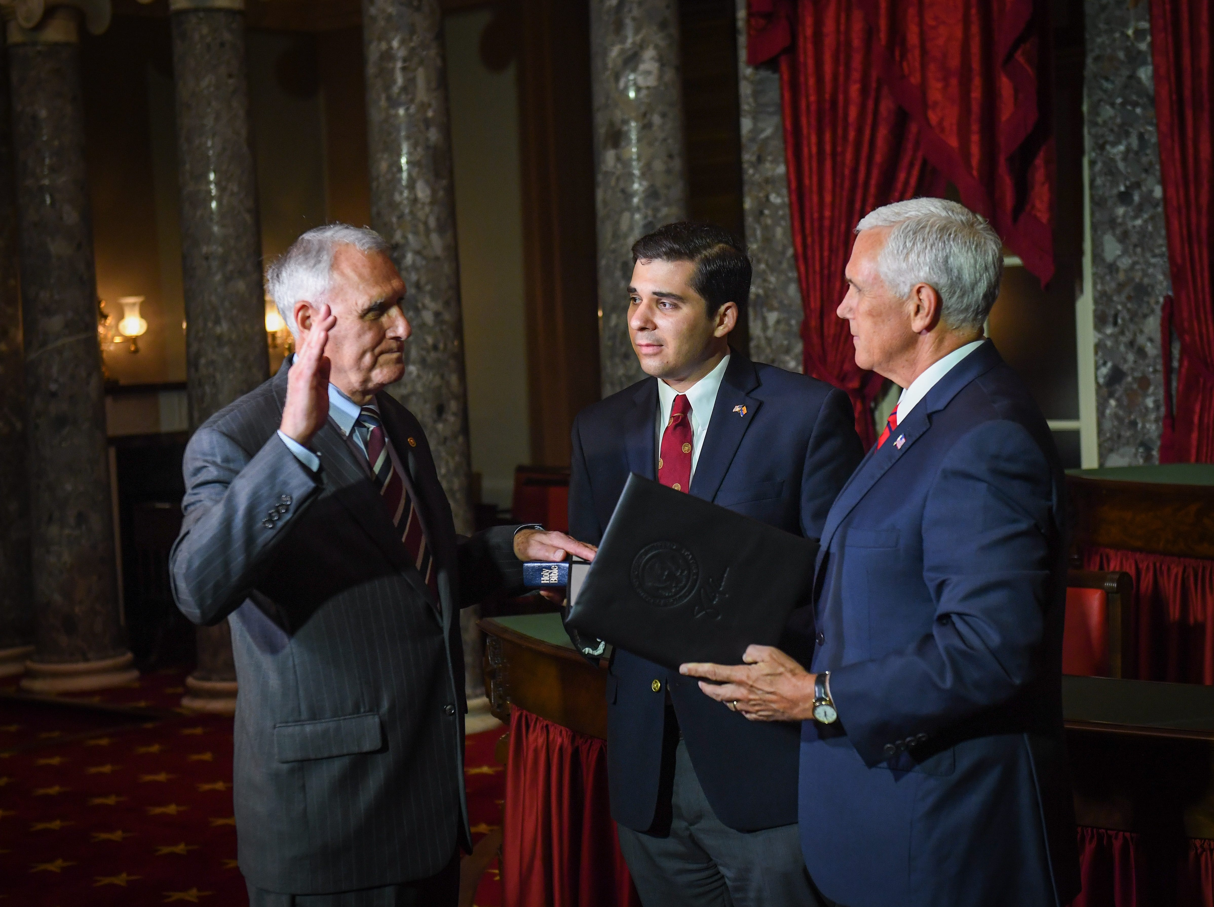 Jon Kyl was sworn-in by Vice President Mike Pence during a reenactment ceremony on Sept. 5, 2018 in Washington along with Kyl's grandson Christopher Gavin. Sen. Kyl was officially sworn-in during a ceremony in the Senate Chamber earlier in the day.