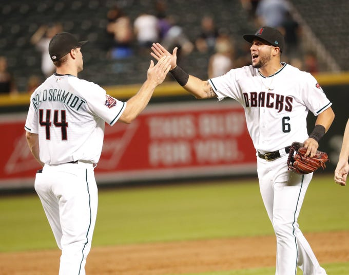Arizona Diamondbacks first baseman Paul Goldschmidt (44) and left fielder David Peralta (6) celebrate their 6-0 win against the San Diego Padres at Chase Field in Phoenix, Ariz. September 4. 2018.