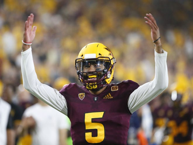 Arizona State Sun Devils quarterback Manny Wilkins (5) celebrates a touchdown during the third quarter of a football game against the UTSA Roadrunners at Sun Devil Stadium in Tempe on September 1, 2018.