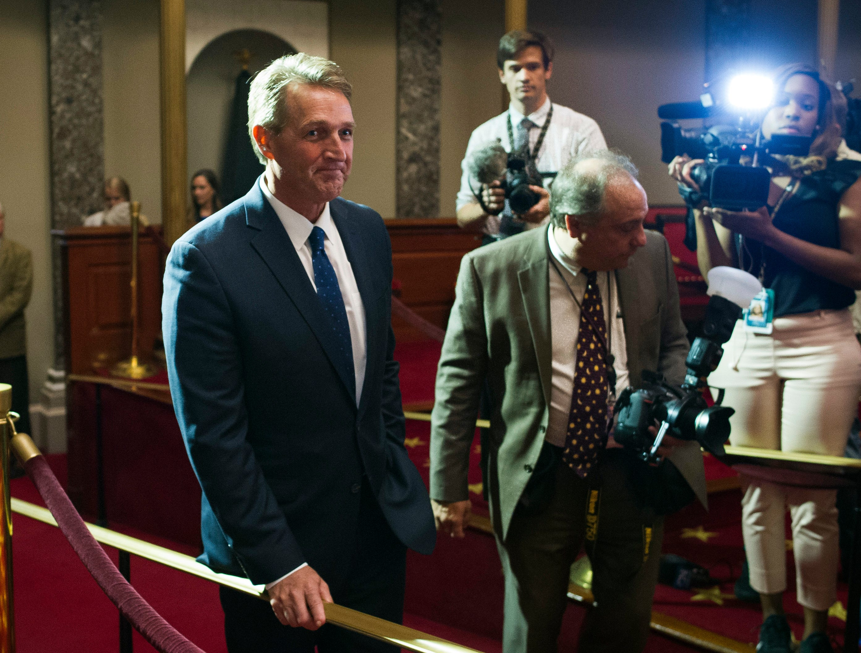 Sen. Jeff Flake, R-Ariz., arrives in the Old Senate Chamber to watch Vice President Mike Pence administer the Oath of Office to Sen. Jon Kyl, R-Ariz., during a ceremonial swearing-in at the Old Senate Chamber on Capitol Hill, in Washington, on Sept. 5, 2018.