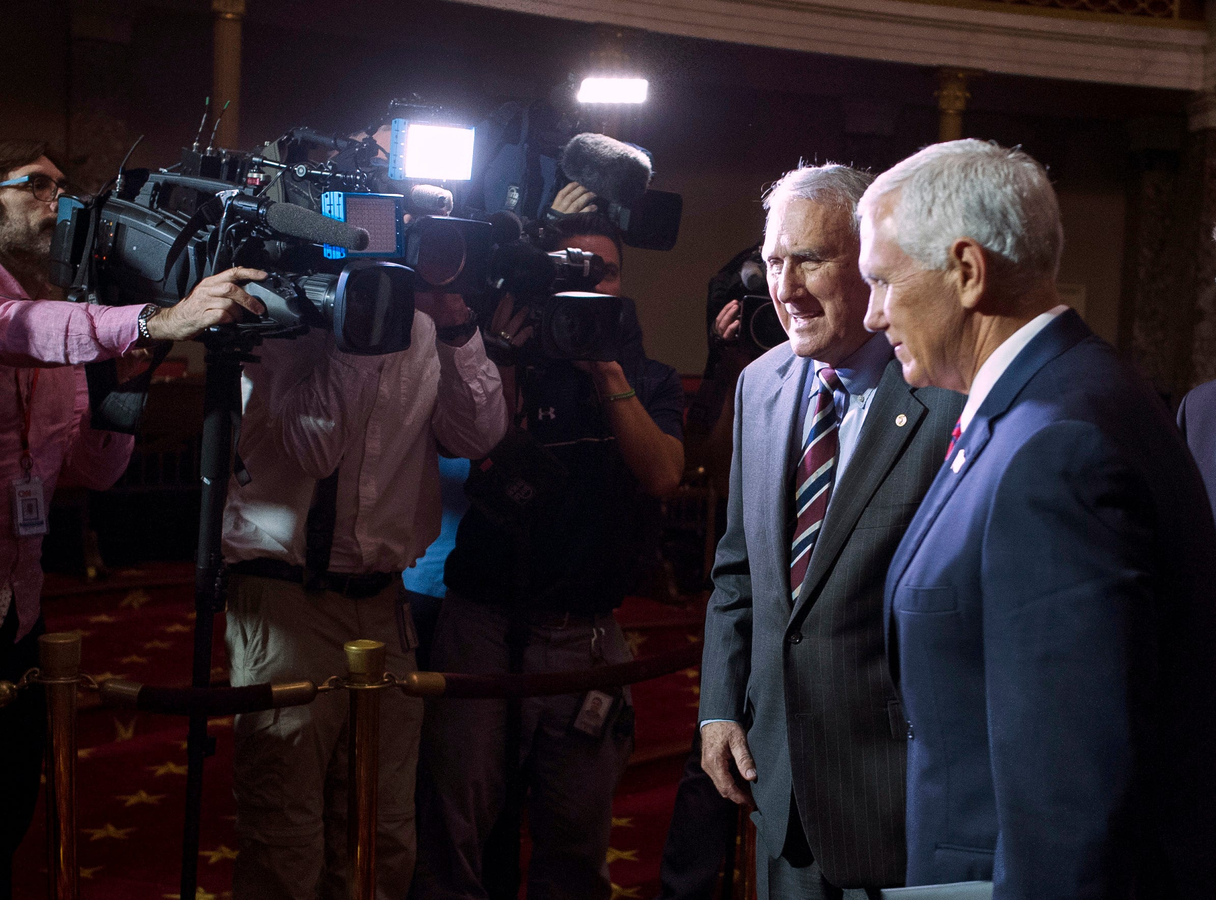 Vice President Mike Pence (right) and Sen. Jon Kyl, R-Ariz., leave the Old Senate Chamber after a ceremonial swearing-in for Kyl on Capitol Hill, in Washington, on Sept. 5, 2018.