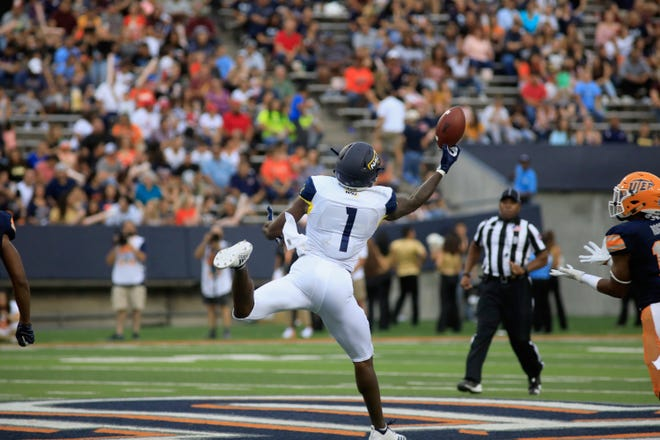 Emmanuel Butler makes one-handed catch as NAU beats UTEP 30-10 on Sept. 1.