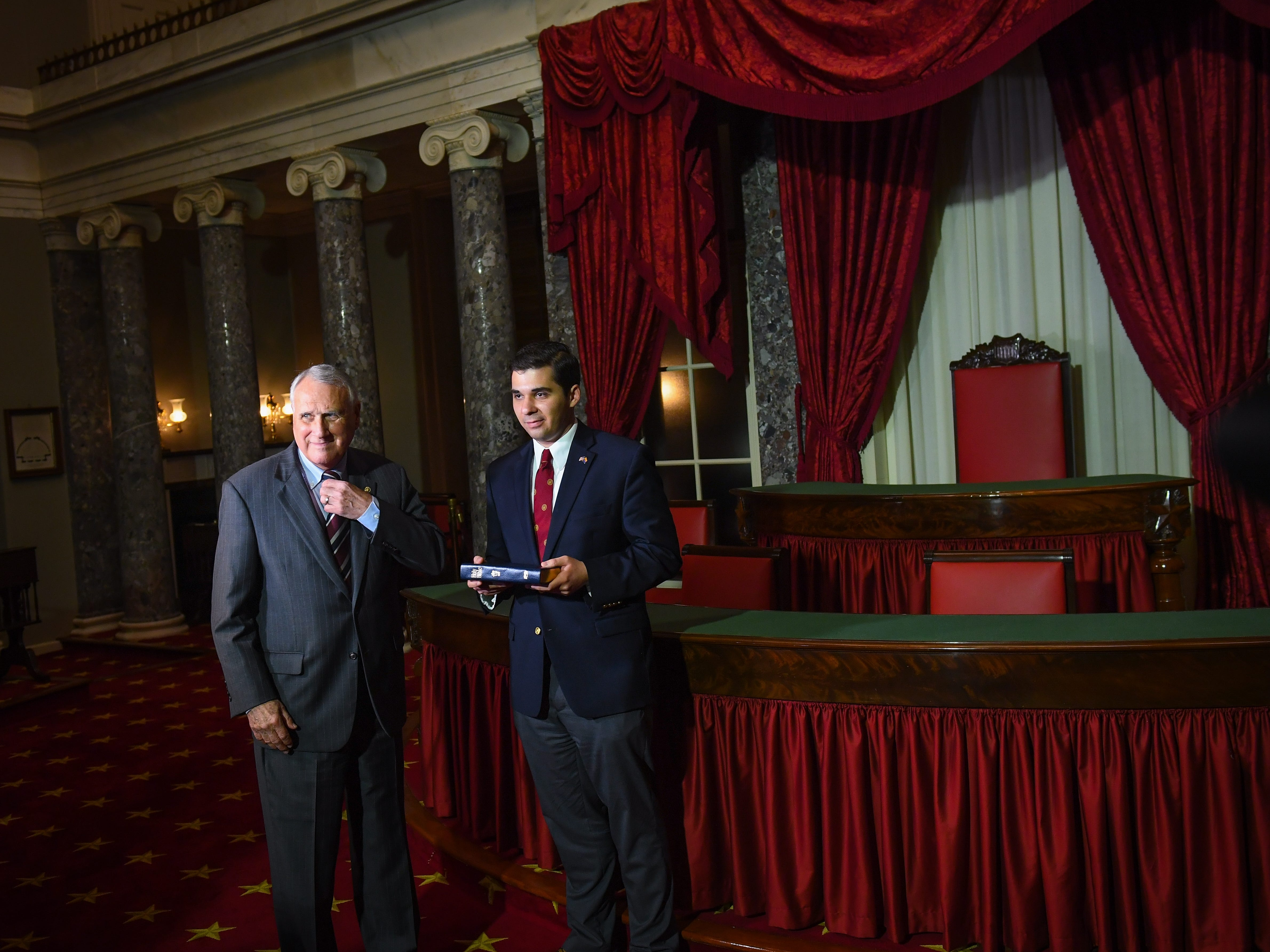 Jon Kyl waiting to be sworn-in by Vice President Mike Pence during a reenactment ceremony on Sept. 5, 2018, in Washington with Kyl's grandson Christoper Gavin.