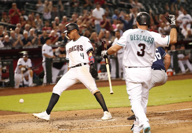 Arizona Diamondbacks second baseman Ketel Marte (4) scores from third base after a pass ball against the San Diego Padres during the seventh inning at Chase Field in Phoenix, Ariz. Sept. 4, 2018.