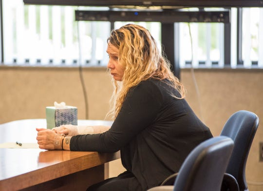 Theresa Gafken waits at the defendant's table while her attorney, Edward Marshall, questions potential jurors Wednesday, Sept. 5, 2018, in Circuit Judge Michael West's courtroom.