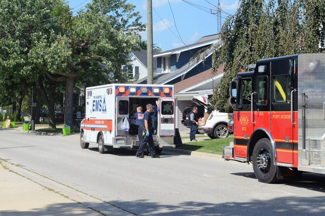 First responders load a person into an ambulance after removing them from a residence on Michigan Street on Sept. 5, 2018, in Port Huron.