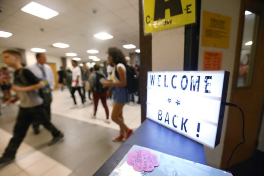 Students walk passed the attendance office during the first day of school at Beacon High School on September 5, 2018.
