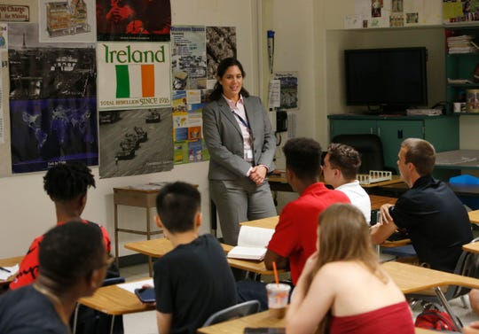 Beacon High School principal Elisa Soto talks with students during the first day of school on September 5, 2018.