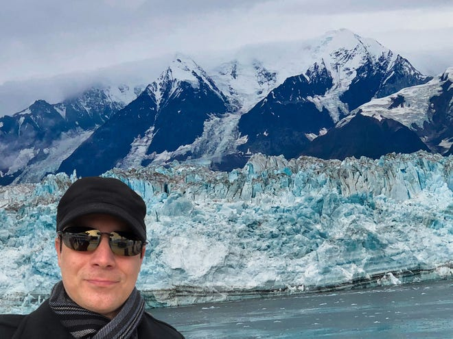 Magician David Haines takes a moment to enjoy the Hubbard Glacier in Alaska during a break in his show aboard the Norwegian Cruise Line.