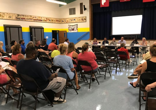 Dozens of concerned parents and residents attend an informational meeting on a mold issue at North Park Elementary School in the Hyde Park school district.